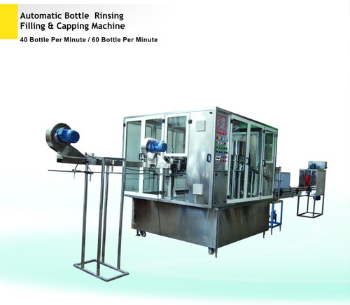 automatic bottle rinsing filling and capping machine 500x500 1