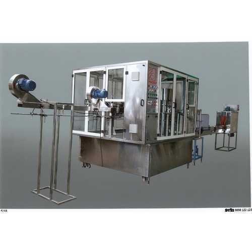 automatic bottle rinsing filling capping machine 500x500 1